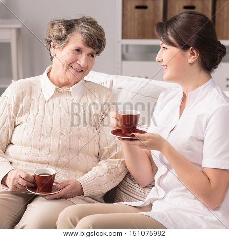Nurse Visiting Patient At Home