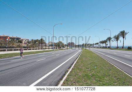 PALMA DE MALLORCA BALEARIC ISLANDS SPAIN - APRIL 10 2016: Paseo Maritimo nearly empty on day of Women's Marathon in Palma de Mallorca Balearic islands Spain on April 10 2016.