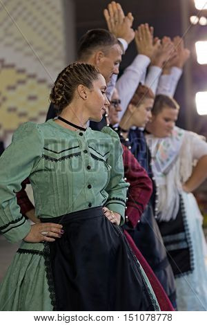 ROMANIA TIMISOARA - SEPTEMBER 24 2016: German dancers in traditional costume perform folk dance during