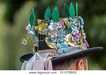 Hats traditional German male decorated with popular models and placed on a man's head.