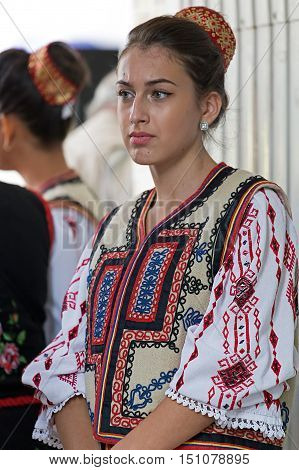 ROMANIA TIMISOARA - SEPTEMBER 24 2016: Young Romanian woman in traditional costume present at the international folk festival