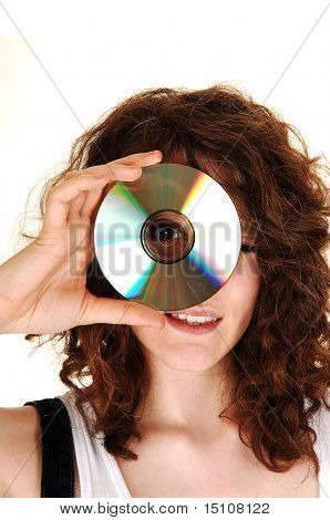 Girl Looking Through A Disk.