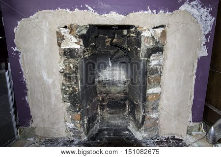 An old Victorian fireplace in the process of being renovated.