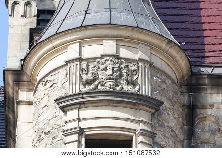 MOSZNA POLAND - OCTOBER 07 2016 :Details of facade 17th century Moszna Castle on a sunny day.It is a historic castle and residence located in a small village one of the best known monuments in the western part of Upper Silesia.