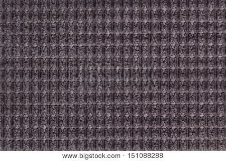 Dark brown background from soft fleecy fabric close up. Texture of textiles macro.