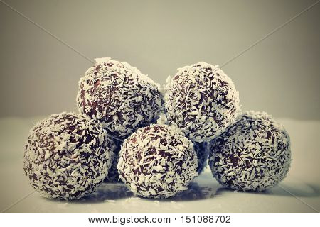 Homemade coconut rum balls on plate. Christmas sweets. Traditional homemade handmade Czech sweets.