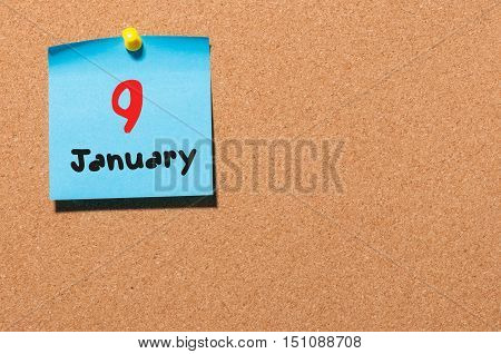 January 9th. Day 9 of month, Calendar on cork notice board. Winter time. Empty space for text.