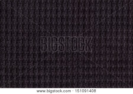 Black background from soft fleecy fabric close up. Texture of textiles macro.