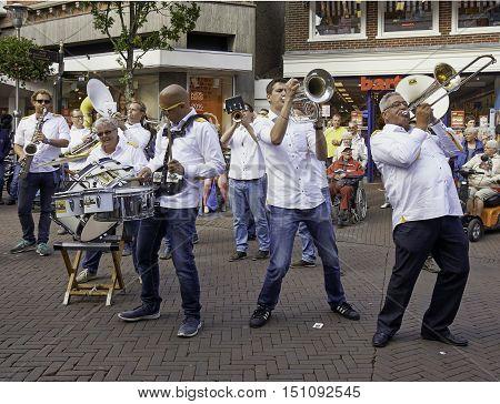 SNEEK, THE NETHERLANDS - OCTOBER 1, 2016: Dweilorkest De Knotwilgen performing at the streets of Sneek, during the annual Dweildag.