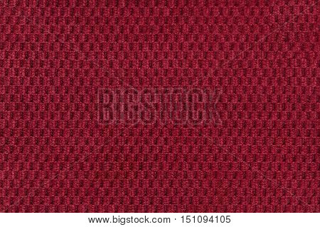 Red background from soft fleecy fabric closeup. Texture of textile macro.