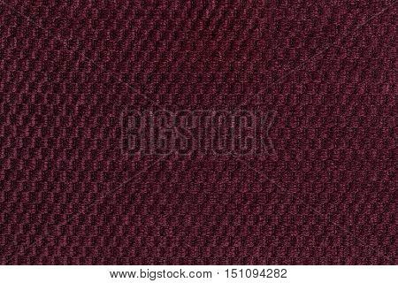 Dark purple background from soft fleecy fabric closeup. Texture of textile macro.