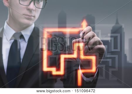 Businessman with maze in difficult situations concept
