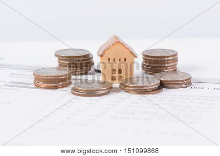 The house and coins stack, realestate concept