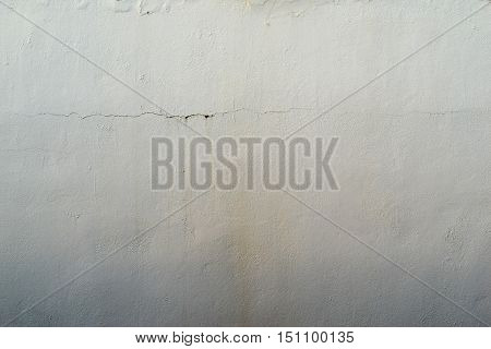 the abstract textured background of an old surface of the plastered wall of a motley silvery color tonality