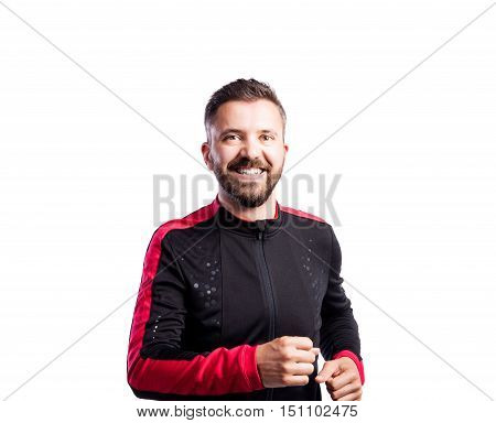 Hipster man in sports sweatshirt. Studio shot on white background, isolated.