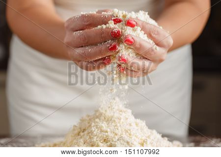 Knead dough with womans hands on table