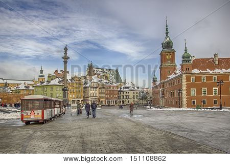 Warsaw Poland - October 28 2012: View of Castle Real square and the typical colorful houses in the background. We are in the famous