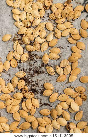 roasted spicy hokkaido pumpkin seed on white kitchen paper