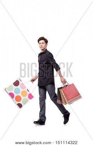 Young man in shopping concept isolated on white
