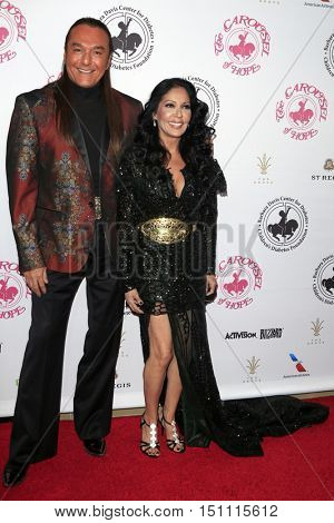 LOS ANGELES - OCT 8:  Nick Chavez, Apollonia Kotero at the 2016 Carousel Of Hope Ball at the Beverly Hilton Hotel on October 8, 2016 in Beverly Hills, CA