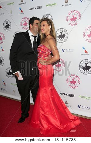 LOS ANGELES - OCT 8:  Jason Davis, Natalie Burn at the 2016 Carousel Of Hope Ball at the Beverly Hilton Hotel on October 8, 2016 in Beverly Hills, CA