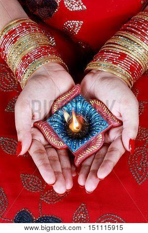 Indian Festival Diwali Diya Lamp in Female Hand