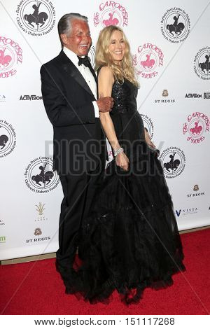 LOS ANGELES - OCT 8:  George Hamilton, Alana Stewart at the 2016 Carousel Of Hope Ball at the Beverly Hilton Hotel on October 8, 2016 in Beverly Hills, CA