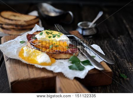 Poached egg with bacon and toaster on paper