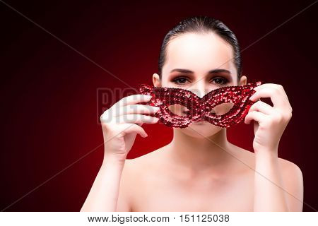 Young woman with mask in halloween concept