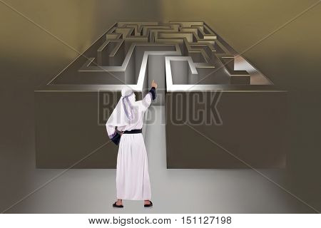 Arab man in front of maze