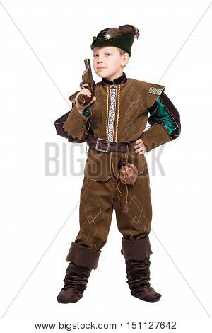 Young boy with the gun dressed as a medieval hunter. Isolated on white