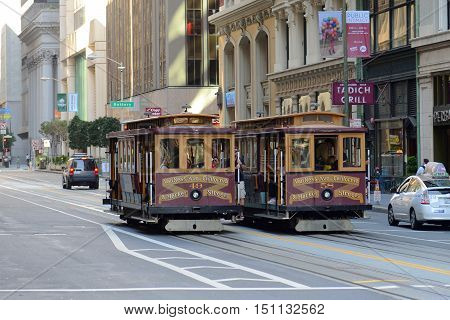 SAN FRANCISCO - MARCH 15: Antique Cable Car on California Street on March 15th, 2014 in downtown San Francisco, California, USA.