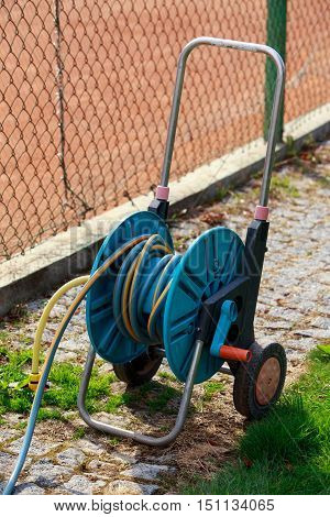 the blue hose for watering a lawn