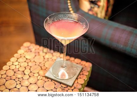 Cosmopolitan Cocktail in a fancy coffee table