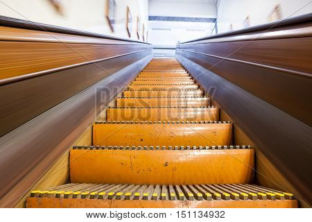 at the station have several wooden escalators for each person