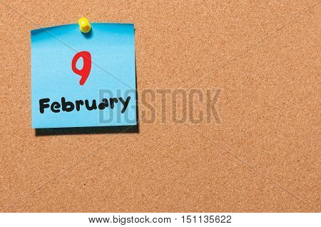 February 9th. Day 9 of month, calendar on cork notice board background. Winter concept. Empty space for text.
