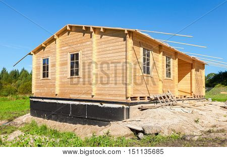 Construction of a new wooden house in summer sunny day