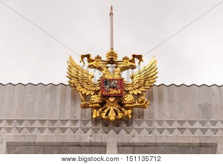 Golden eagle symbol on the roof top of the Kremlin concert hall in Moscow Russia.
