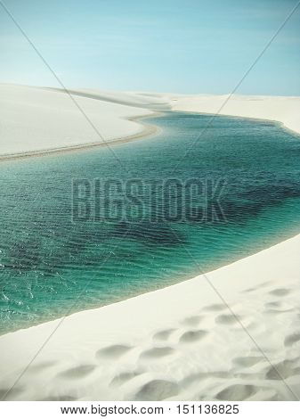 Natural rainwater pools in Lencois Maranhenses National Park seen from above Maranhao Brazil
