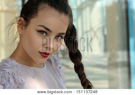Portrait Of A Beautiful Girl With A Pigtail