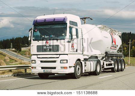 BRASOV ROMANIA - NOV 102014: Man truck with cistern on highway near the Romanian city of Brasov