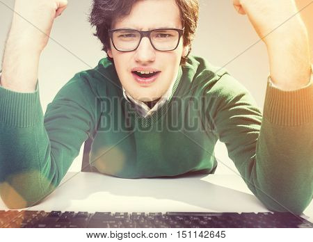 Furious Gesticulating Man In Glasses