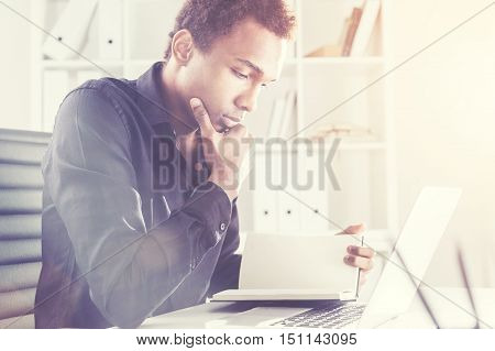African Businessman Reading Book