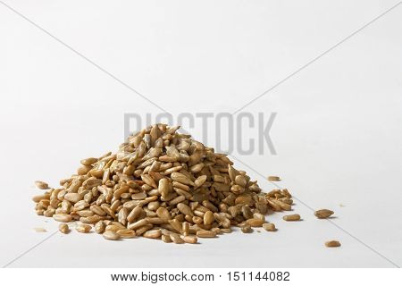 Close up of hulled sunflower seeds isolated on white background