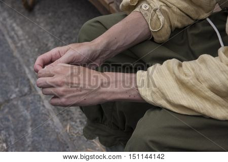A hard-working male laborer's hands showing the veins