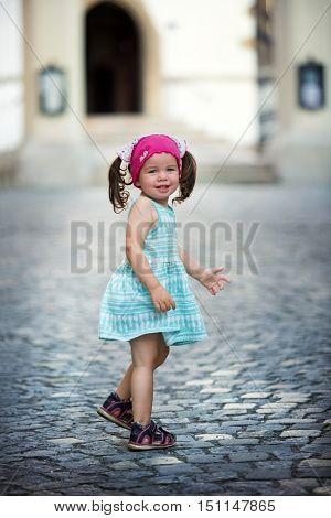 Little girl standing on the road before entering the church