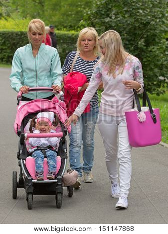 Grandmother with her daughter and granddaughter for a walk in the park