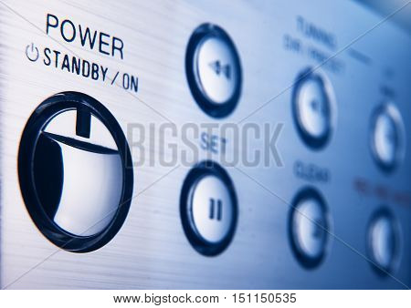 Power button on control panel in blue