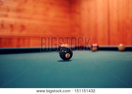 6 ball on a pool table. focus on the ball