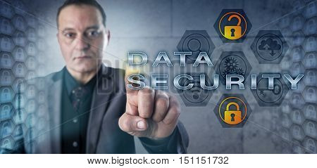 Hard-nosed cyber investigator activating DATA SECURITY. Information technology metaphor and cybersecurity concept for data protection from unauthorized access encryption and computer security.